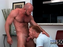 Hairy muscular man gets his cock sucked