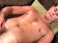 Masturbating young guy models his asshole