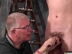 Matured BDSM master gives twink a handjob