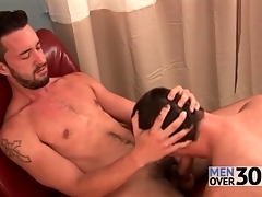 Outrageous pubes and beard on coxcomb getting a blowjob